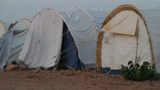 Panning Shot Of Un Refugee Tents