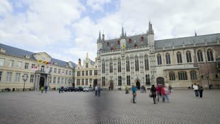 Panning Time lapse transition of the traditional Market Square in Bruges with Restaurants, Pubs and shops, Belgium, Europe