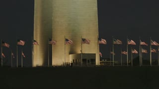 panorama of flags waving at night in DC