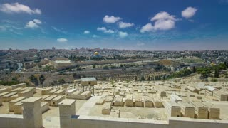 Panoramic view on Jerusalem timelapse hyperlapse with the Dome of the Rock from the Mount of Olives. Blue sky at summer day