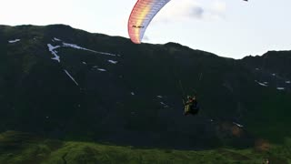 Paraglider Soars Over Alaskan Mountains