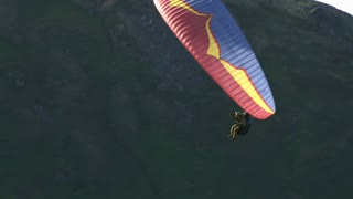 Paraglider Swooping Over Mountainside