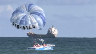 Parasail Boat Floating in Ocean