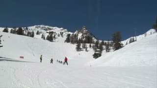 Parents Flank Little Skiing Son, Blue Sky Day