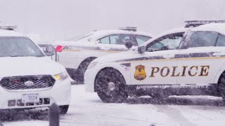 Parked Police Cruisers In Snow