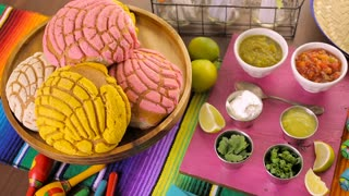 Party table with tamales, strawberry margaritas and pan dulche bread.