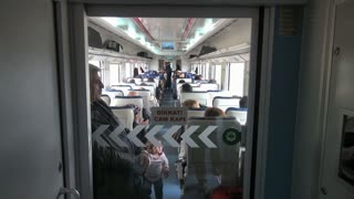 Passengers on Quiet Train Car