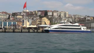 Passing by Ferry Docked on Bosphorus