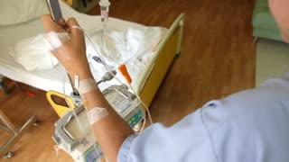 Patient with Intravenous IV Drip in Hospital Ward