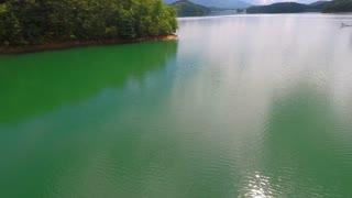 Peaceful flight over an emerald lake