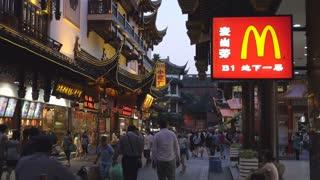 Pedestrians in Shanghai Street Near McDonald's