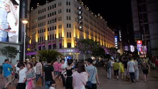 Pedestrians on Nanjing Road at Night in Shanghai