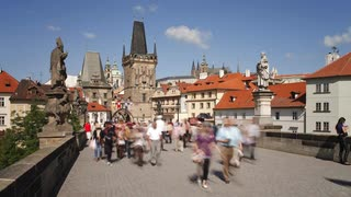 Pedestrians walking across Charles Bridge, Prague, Czech Republic, Europe, T/Lapse