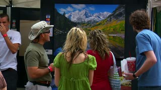 People Admire Painting At Arts Festival