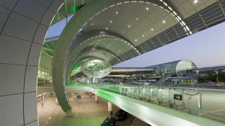 People arriving and departing from Dubai International Airport with a Futuristic Modern Design, Dubai, UAE - T/Lapse