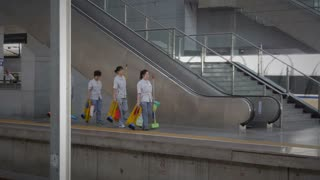 People Cleaning China's Train Station