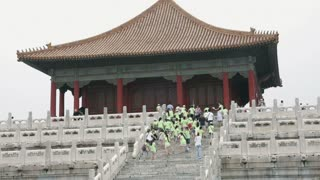 People Climbing Stairs to Forbidden City Temple