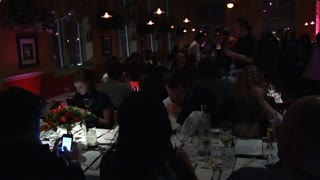People Dining  At Busy Restaurant