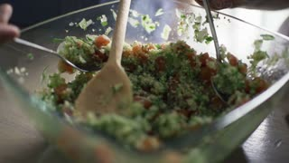 People eating salad from bowl, slow motion shot at 240fps