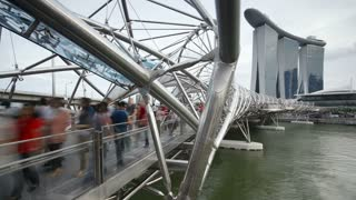 People on the Helix Bridge and Marina Bay Sands Singapore, Marina Bay, Singapore, Asia, Time lapse