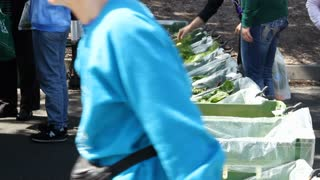 People Shop For Vegetables At Farmer's Market