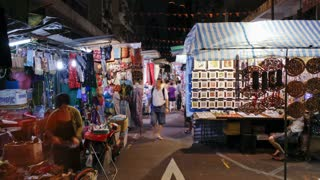 People shopping in Temple Street Night Market, Kowloon, Hong Kong, China, T/lapse