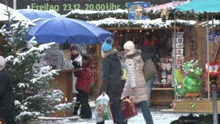 People Shopping In The Snow