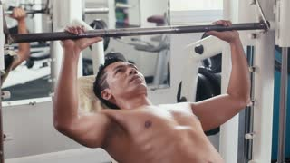 People training, working out, exercise in gym and fitness club, sport and bodybuilding for wellness and wellbeing. Man, athlete practicing as bodybuilder, weightlifting with equipment