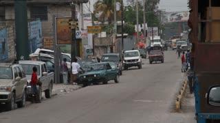 People Walk Across Street In Haiti