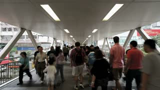 People walking across an elevated walkway in Central, Hong Kong Island, Hong Kong, China, T/lapse