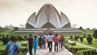 People walking along a causeway in front of the Lotus Temple (Baha'i Temple), the Lotus Temple in Delhi is the latest of seven such temples around the world, Delhi, India - Time lapse