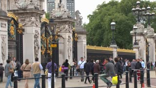People Walking By Buckingham Palace Front Gates