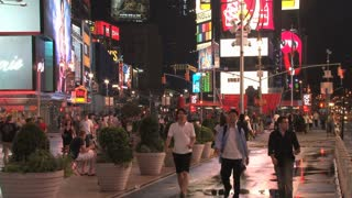 People Walking Down Times Square Street