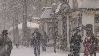 People Walking In Snow Storm