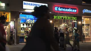 People Walking on Ocean City Maryland Boardwalk at Night 3