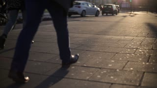 People walking on pavement in the city