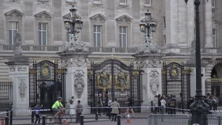 People Walking Outside Gates at Buckingham Palace