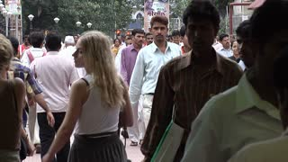 People Walking Through Bustling Market in Mumbai
