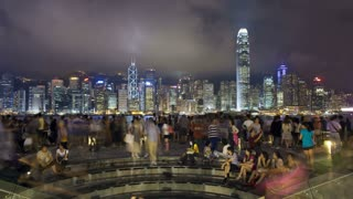 People watching the world famous Sound and Light show, Hong Kong City skyline looking across Victoria harbour to Hong Kong Island at night, Hong Kong, China, Asia, T/lapse