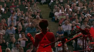 Performer Sings To Crowd At Concert