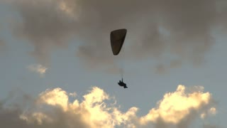 Person in Parachute in Sky