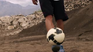 Person Juggling Soccer Ball in Slow Motion