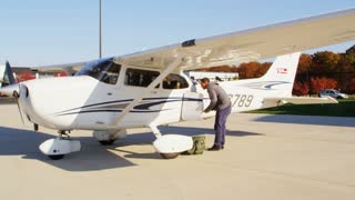 Pilot Checking Plane