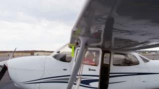 Pilot Prepping Plane