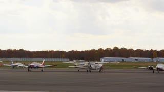 Pilot Tending to Plane