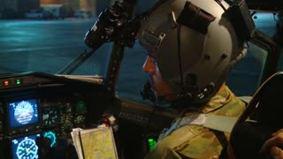 Pilot with night vision goggles ready for C-130H Hercules Airdrop