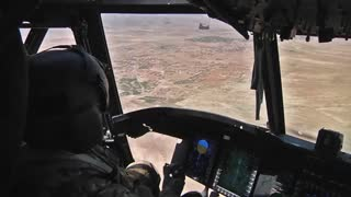 Pilots fly  CH-47F Chinook helicopters