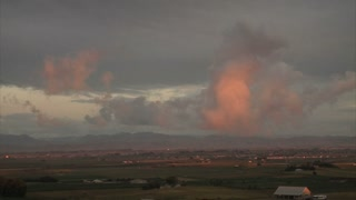 Pink Clouds Turning Gray Over Countryside