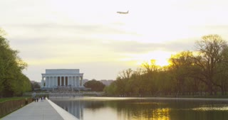Plane Flying Over Lincoln Memorial