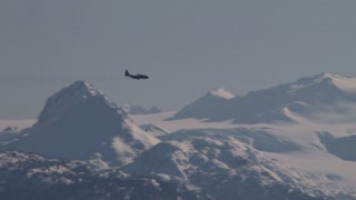 Plane Flying Over Mountains 2